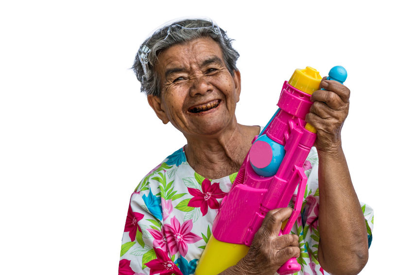 ASIA Songkran Songkran Festival Thailand Adult Cut Out Grandma Happiness Indoors  Isolated White Background Lifestyles One Person Smiling Songkran Thailand Studio Shot Water Gun White Background