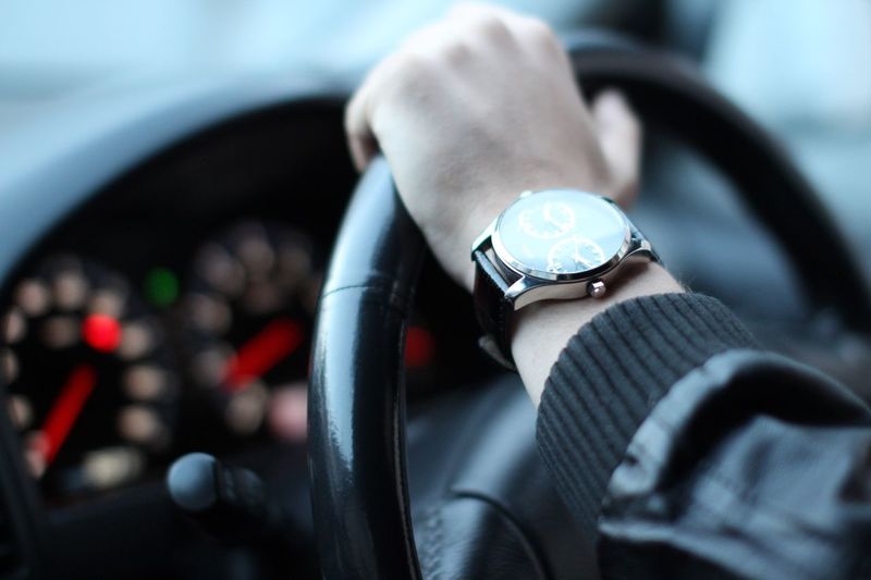 Mensfashion Menswear Well-dressed Casual Clothing Wristwatch Car Human Hand One Person Time Close-up Focus On Foreground Transportation Watch Men Real People Human Body Part Day Indoors  Speedometer Clock One Man Only People Car Wheel This Is Masculinity