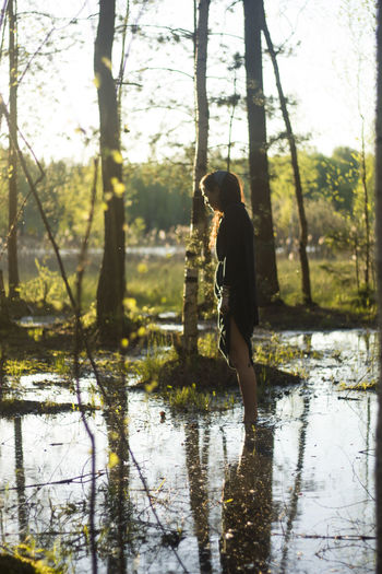 The girl in the forest. Natural beauty. Loneliness in society. Beautiful nature. Fashion photography. Beautiful girl walks through the swamp. Natural lighting in the forest. Birch in the sun. Water Tree Plant One Person Real People Nature Land Beauty In Nature Standing Forest Day Side View Tranquility Reflection Full Length Leisure Activity Lake Lifestyles Outdoors WoodLand Girl Natural Beauty Loneliness Fashion Natural Lighting Photography Birch Walksofitaly Beautiful Girl