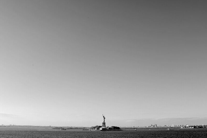Taking the ferry downtown to Staten Island, walking from side of the boat to the other and seeing it. The Moment - 2015 EyeEm Awards Statue Of Liberty New York Blackandwhite 1 / 7 Series EyeEm Best Shots