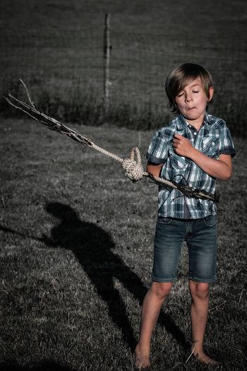 Portrait of boy standing on shore