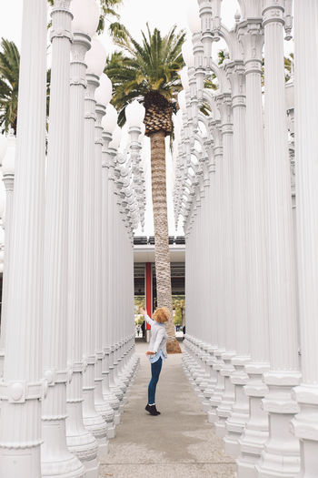 Architecture California City Los Angeles, California Tourist Attraction  Architectural Column Architecture Building Exterior Built Structure Casual Clothing Curly Hair Day Full Length Girl History In A Row La Men One Person Outdoors Real People Rear View Standing The Way Forward Tourist Destination Travel Destinations Young Adult