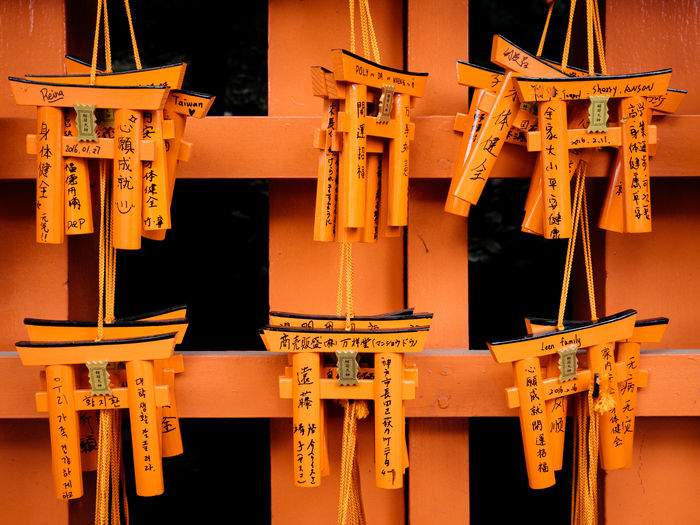 Replicas Of Torii Gates Hanging Against Orange Gate