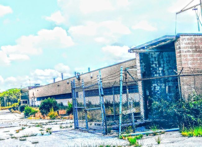 Taking Photos Old Buildings Clouds And Sky Colorful Abandoned Buildings Fenced In Barbed Wire Shrubcolors Parking Lot