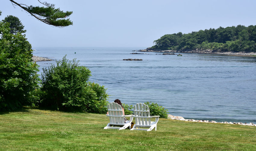 Lawn chairs in Summer on New England Coast New England  Summertime Backgrounds Beach Beauty In Nature Bradley Olson Bradleywarren Photography Couple - Relationship Day Grass Horizon Over Water Land Men Nature Non-urban Scene Outdoors Plant Real People Scenics Scenics - Nature Sea Seat Sitting Sky Summer Tourism Tourist Destination Tranquility Tree Two People Water