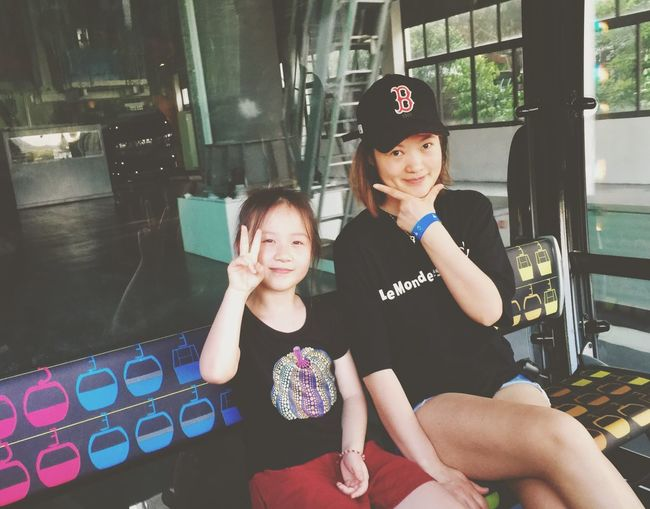 Exploring Random Taking Photos Travel Destinations Sentosa Cable Car Having Fun Mother & Daughter Sitting Real People Communication Two People Indoors  Boys Girls Happiness Day