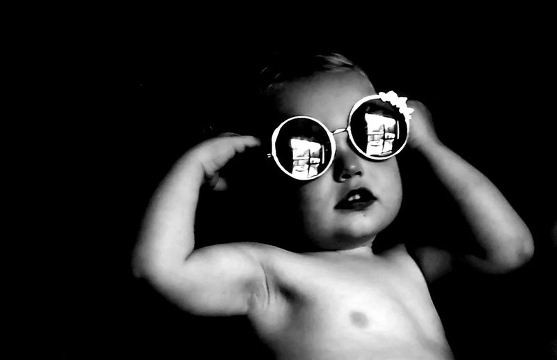 Portrait of shirtless boy wearing sunglasses