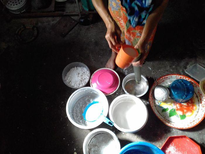 "A women are making a "" lemang buluh"" for festive season. Bamboo Products Lemang Festival Season Hari Raya Aidilfitri EyeEm Selects Human Hand Multi Colored Artist Aerosol Can Palette Child Paint Creativity Close-up"