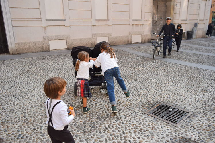 Child Childhood Togetherness Boys Females Girls Males  Standing Women Men Streetwise Photography