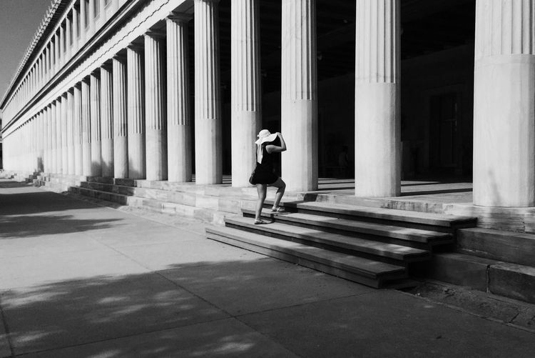 Woman On Steps At Historic Stoa Of Attalos