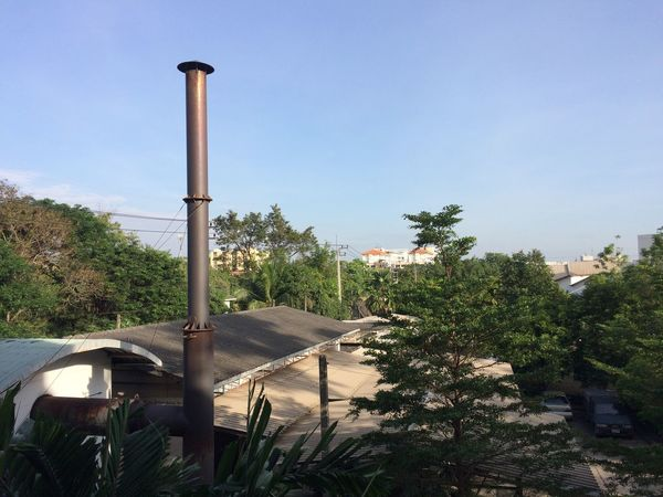 Flue Smokestack Tree Built Structure Day Architecture Outdoors No People Nature Clear Sky Sky Growth Building Exterior Beauty In Nature Water