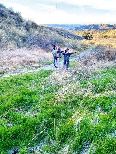 People on grassy field
