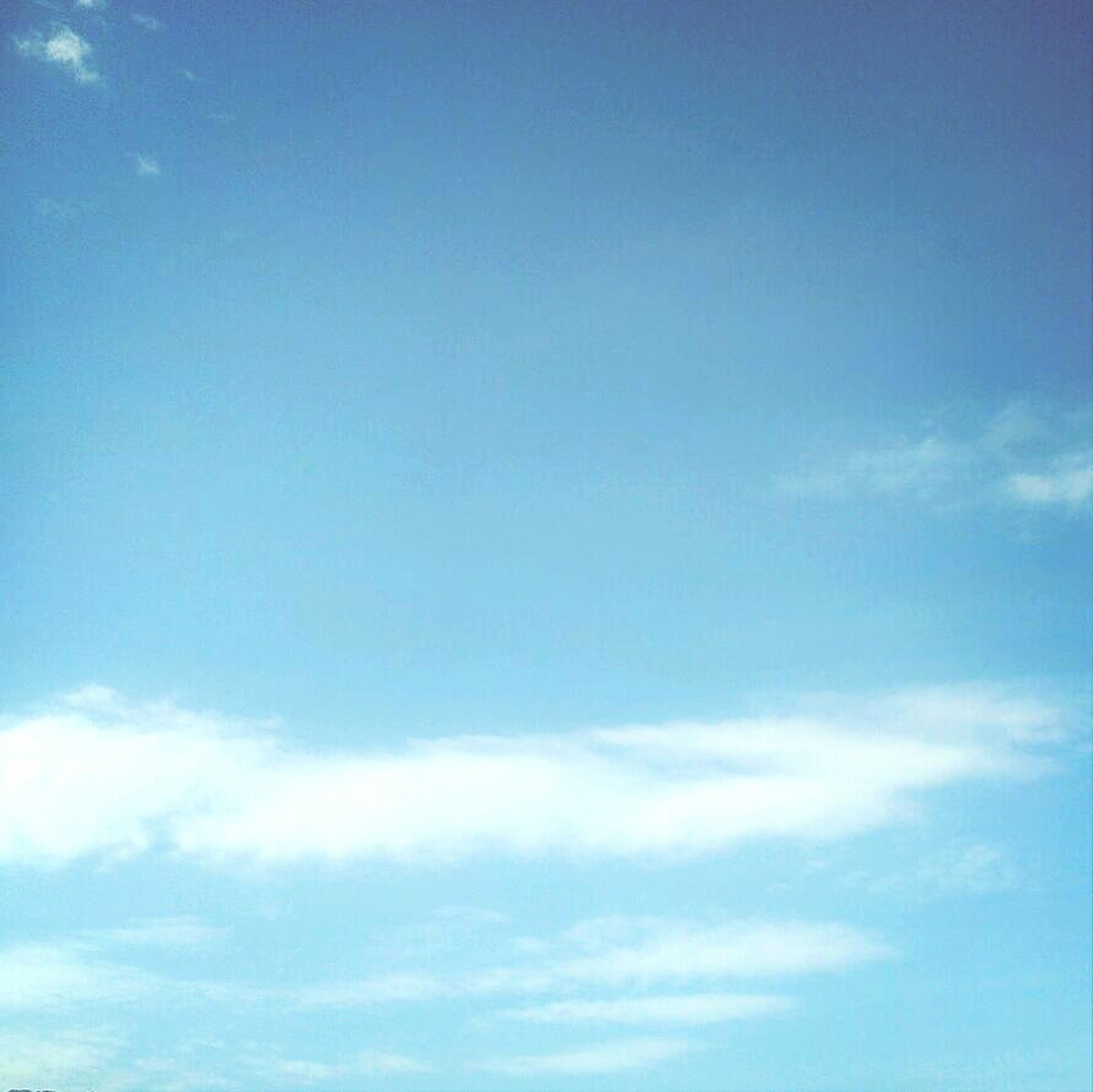 blue, sky, low angle view, beauty in nature, tranquility, scenics, tranquil scene, cloud - sky, nature, sky only, copy space, cloud, idyllic, day, white color, outdoors, backgrounds, no people, cloudscape, cloudy