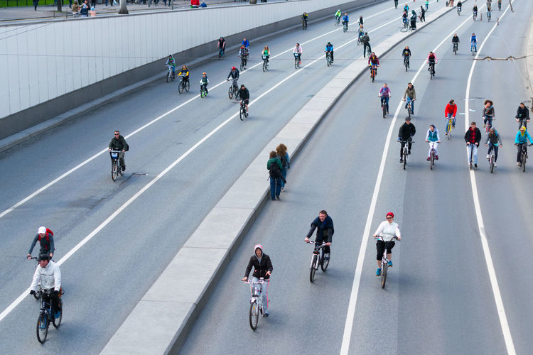 High angle view of people riding bicycles on road