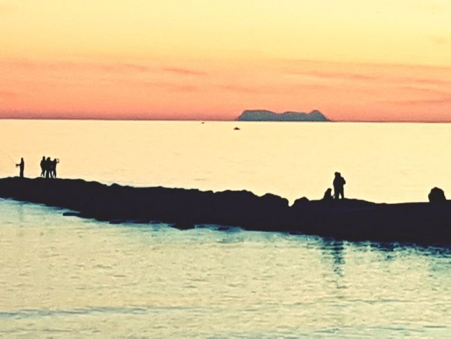 Sea Sunset Outdoors Sky Beauty In Nature Water Beach Horizon Over Water Real People People Nature Adults Only Beauty In Nature Sunlight Marbella EyeEmNewHere Gibraltar Rock Gibraltar Views FromMarbella