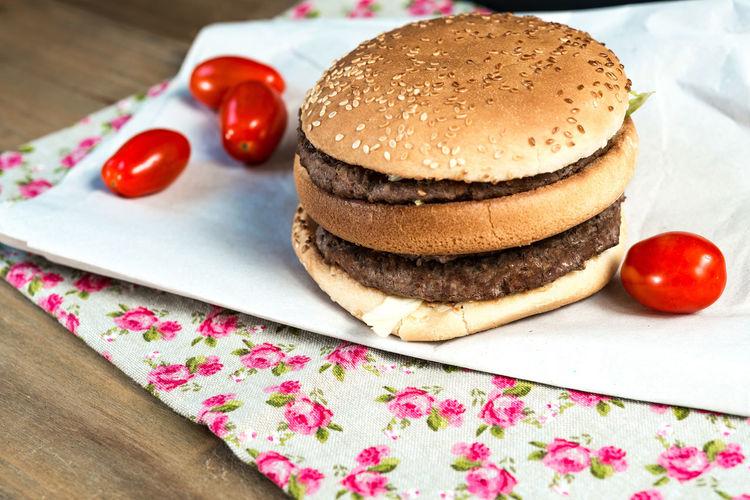 Close-up of cheeseburger on napkin