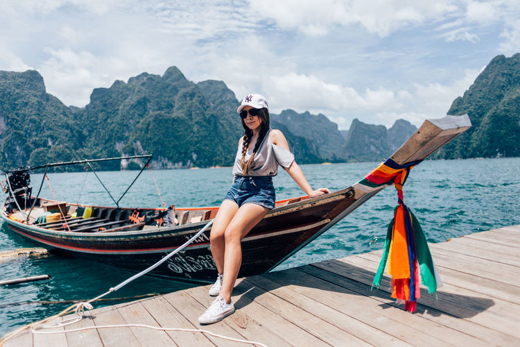 Full length of young woman on boat against sea