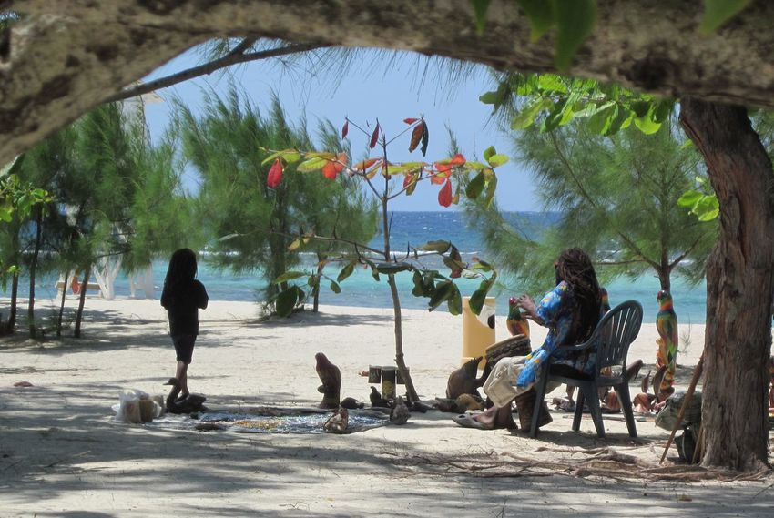 Adult Art Beach Beauty In Nature Branch Caribbean Life Caribbean Sea Day Dredlocks Full Length Jamaican Leisure Activity Lifestyles Nature Outdoors Real People Sea Sitting Sunlight Togetherness Tree Water Neighborhood Map