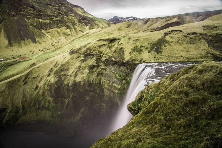 Skogafoss Beauty In Nature Day Environment Falling Water Flowing Flowing Water Formation Idyllic Landscape Long Exposure Motion Mountain Mountain Range Nature No People Non-urban Scene Outdoors Rock Scenics - Nature Tranquil Scene Tranquility Water Waterfall The Traveler - 2018 EyeEm Awards
