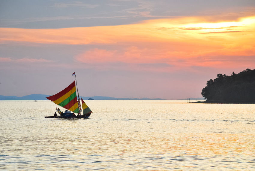 Sunset Religion Tradition Travel Beauty Nature Landscape EyeEm Best EditsSea Sailing Ship Boats⛵️ Penyengat Island Beauty In Nature EyeEmNewHere Sailing PenyengatIsland Travel Destinations Decorative Ship Stockphoto EyeEm Selects Sailing Boat Ship Beach Multi Colored Beauty In Nature
