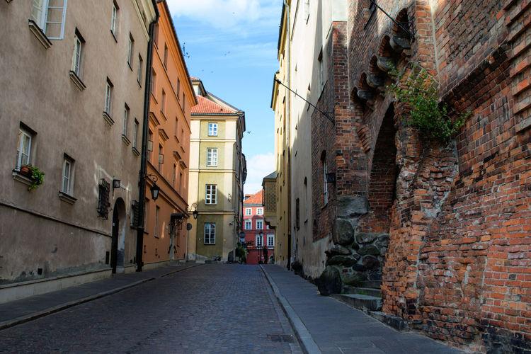Narrow alley along buildings in city