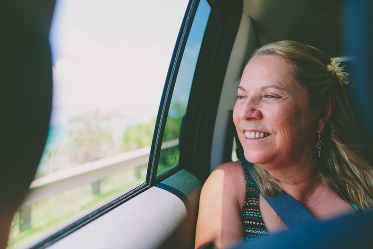 Smiling Woman Traveling In Car