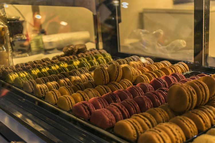 Close-up of macaroons in display cabinet