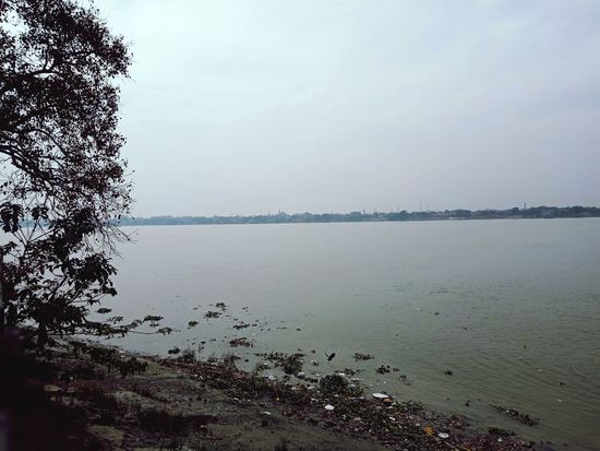 Ganges bank Ganga Ganges River Ganga Ghat Dakshineswar Kali Temple Water Beach Sky Sea Beauty In Nature Tranquility Nature Cloud - Sky Horizon Over Water No People Day Outdoors Scenics Landscape