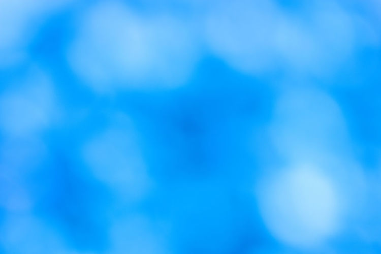 Abstract Blurred blue white bokeh background Blue Backgrounds Abstract No People Defocused Light Blue Sky Abstract Backgrounds Cloud - Sky White Color Full Frame Nature Pattern Scenics - Nature Copy Space Textured  Softness Cloudscape Beauty In Nature Blue Background Clean Turquoise Colored