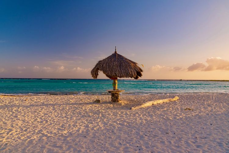 Travel Arid Climate Beach Beauty In Nature Caribbean Day Dutch Horizon Over Water Idyllic Island Leisure Nature No People Outdoors Paradise Resort Sand Scenics Sea Sky South America Summer Sunset Thatched Roof Tranquil Scene Tranquility Travel Destinations Tropical Vacations Water