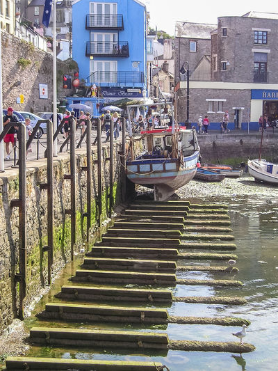 The harbour wall in Brixham, South Devon, UK. Architecture Boat Building Exterior Built Structure Day Harbour Low Tide Marina Mode Of Transport Moored Nautical Vessel Outdoors Tide Out Transportation Travel Water