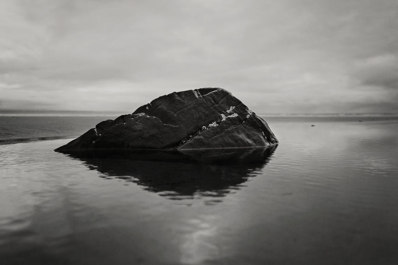 Atmosphere Atmospheric Mood Beauty In Nature Landscape Majestic Monochrome Nature Non-urban Scene Outdoors Reflection Remote Rock Sea Tranquil Scene Water