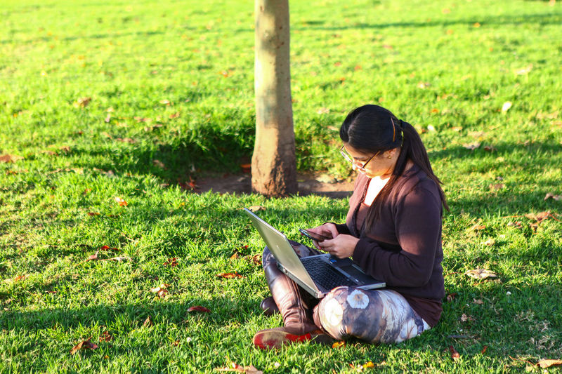 working outside Woman Woman Working Woman Business Bussiness Working Work Outdoor Office Office EyeEm Selects Grass Sitting One Person Day Adult Full Length Looking Down Outdoors People Adults Only Nature Women One Woman Only Only Women Tree