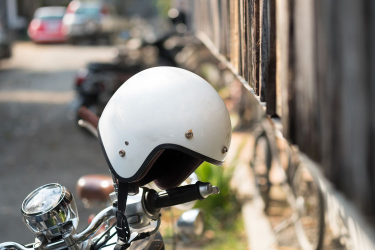 helmet on motorcycleใ Motorcycle Objects Transport Bicycle Bike City Close-up Day Focus On Foreground Headwear Helmet Land Vehicle Mode Of Transport Mortobike Motorcycle No People Outdoors Road Scooter Street Transportation