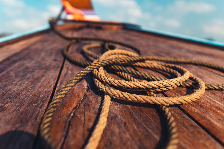 Close-up of rope tied on wood