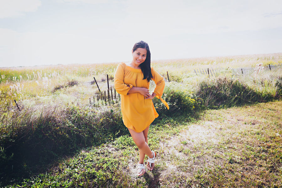 Breezy. Beautiful Woman Beauty Beauty In Nature Casual Clothing Day Field Front View Full Length Grass Hairstyle Land Leisure Activity Lifestyles Nature One Person Outdoors Plant Real People Sky Standing Women Young Adult Young Women