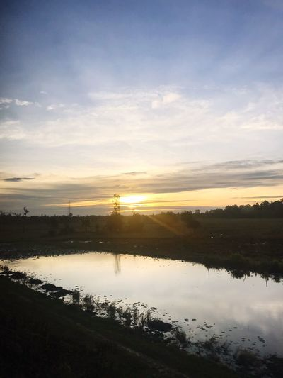 Sunset Water Reflection Sky Beauty In Nature Tranquil Scene No People Nature Scenics Silhouette Tranquility Outdoors Cloud - Sky Lake Tree Day
