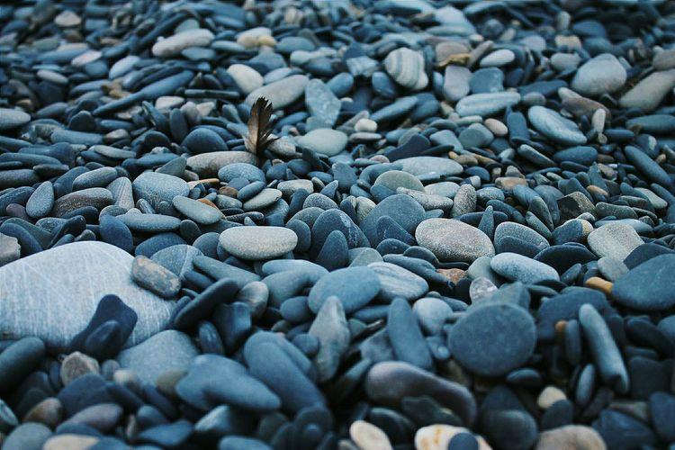 FULL FRAME OF STONES ON BEACH
