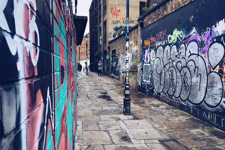 London Alley Graffiti Built Structure Architecture Building Exterior Multi Colored Day Outdoors The Way Forward No People London Alley Cobblestone Walking Wet Rain