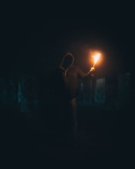 Sparky Night One Person Illuminated Standing Real People Human Arm Dark Three Quarter Length Lifestyles Men Rear View Street Adult Casual Clothing Leisure Activity Holding Architecture Lighting Equipment Arms Raised Human Limb Flame Sparkler Flare