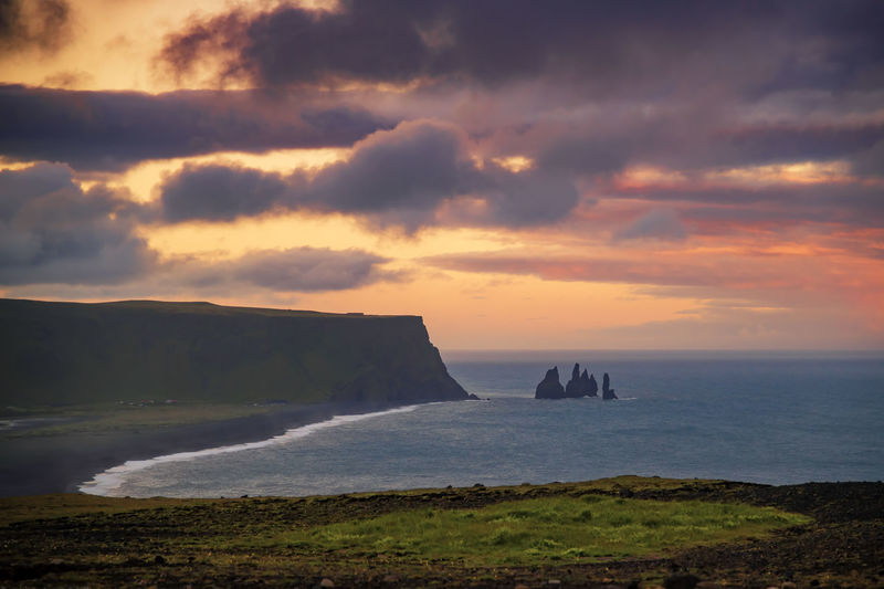 Basalt rock Reynisdrangar shot from Dyrholaey cliffs Vik ,Iceland. Atlantic Ocean Dramatic Sky Dyrhólaey Iceland Midnight Sun Rock Basalt Cliff Iceland_collection Icelandic Icelandic Horse Ocean Reynisdrangar Roadtrip Rock - Object Summer Sunrise Sunset Vik