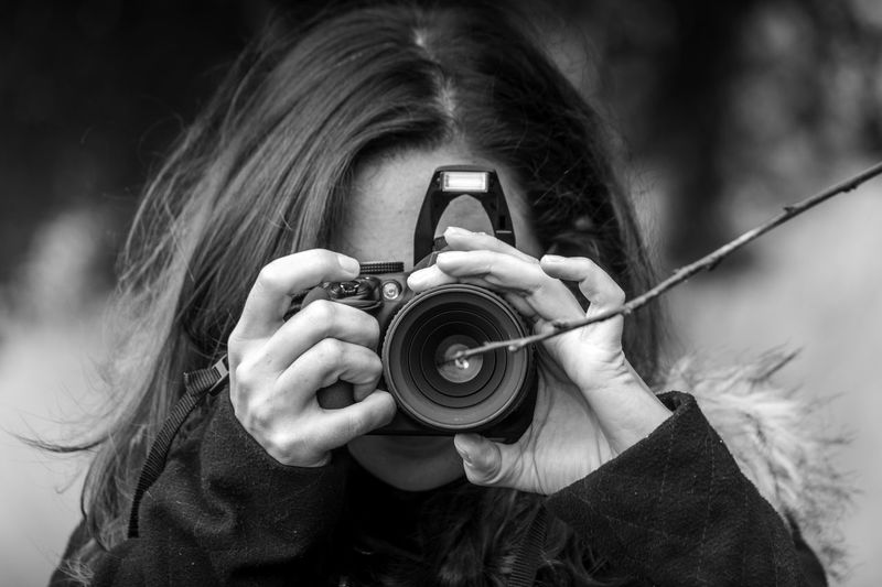 Adult Black And White Camera - Photographic Equipment Childhood Close-up Day Digital Camera Digital Single-lens Reflex Camera Focus On Foreground Front View Headshot Holding Human Body Part Human Hand One Person Outdoors People Photographing Photography Themes Portrait Real People Technology
