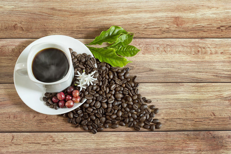 High angle view of coffee and leaves on table