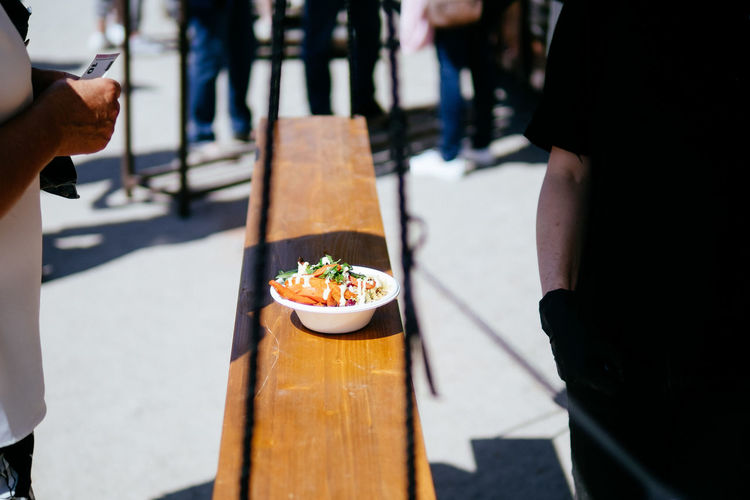 Salad Business Chef Day Focus On Foreground Food Food And Drink Freshness Hand Healthy Eating Healthy Food Incidental People Leisure Activity Lifestyles Men Midsection Outdoors Real People Selective Focus Street Food Table Unrecognizable Person Wood - Material