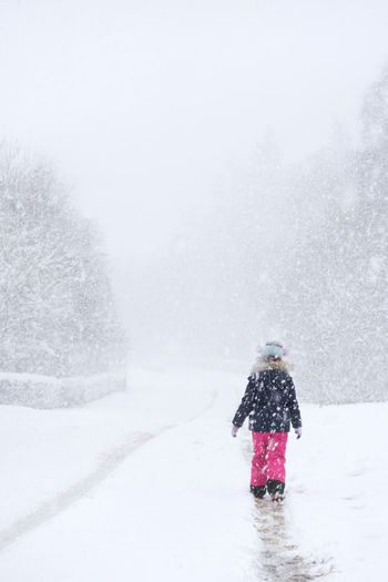 A young girl walking alone in a heavy snow storm Scotland Adult Adults Only Beauty In Nature Cold Temperature Day Full Length Motion Nature One Person Outdoors People Rear View Scenics Snow Snowflake Snowing The Beast From The East Tree Warm Clothing Weather Winter