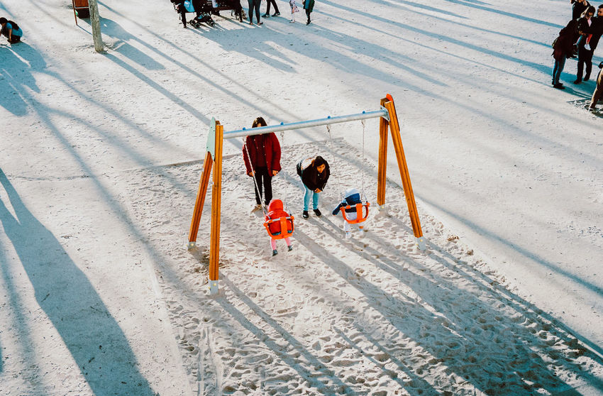 Child Childhood Cold Temperature Competition Day Fun Group Of People High Angle View Leisure Activity Men Motion Nature Offspring Outdoors People Playing Recreational Pursuit Snow Sport Winter Winter Sport