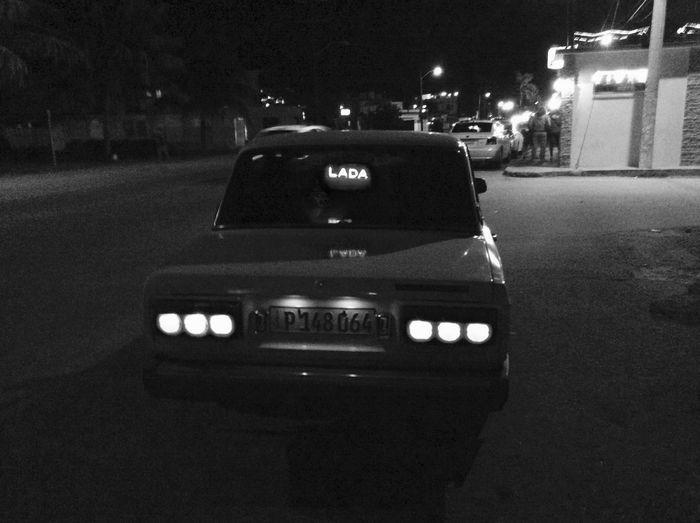 Close-up of car on road at night