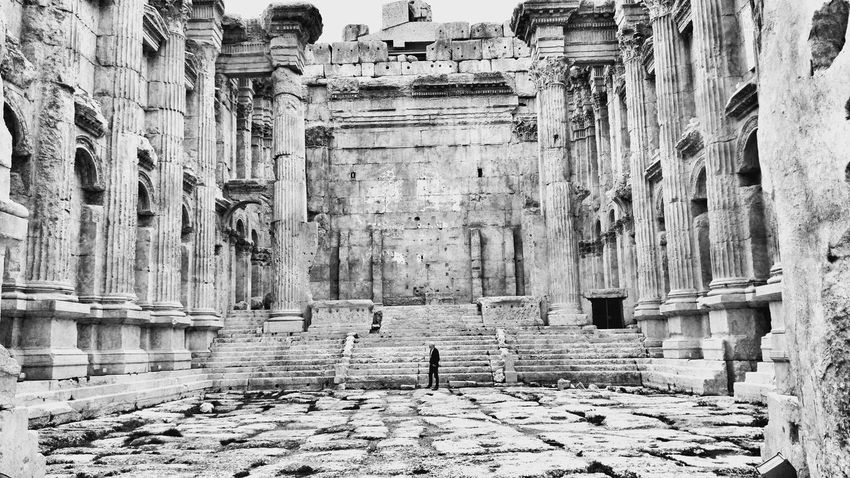 we are so small The Graphic City Bnwphotography Roman Ruins Ancient Civilization Ancient Architecture Roman Temple Lebanon In Photos Lebanon_tourism Ancient Ruins Architecture Textured  Built Structure Pattern Backgrounds Day No People