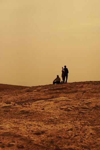 Judea Judean Desert Israel Real People Two People Walking Desert Sunset Sand Togetherness Men Silhouette Nature Full Length Mammal Arid Climate Sand Dune Outdoors Sky Day Adult The Week On EyeEm EyeEmNewHere EyeEm Been There. Lost In The Landscape