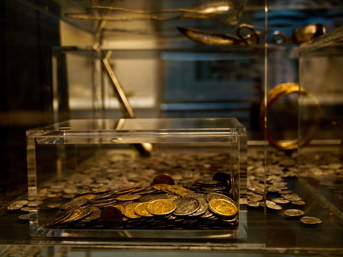 Coins in glass container at museum